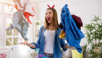Woman annoyed throws her ironing in the air - she needs ironing services